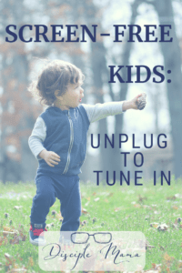 Toddler boy holding a pinecone with text overlay: Screen-Free Kids: Unplug to Tune In
