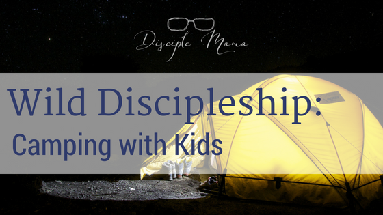 Yellow tent lighted up from the inside with text overlay: Wild Discipleship: Camping with Kids