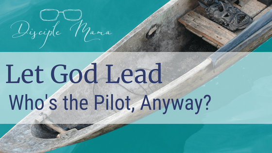 Dugout canoe in the water with text overlay: Let God Lead, Who's the Pilot, Anyway? | Disciple Mama