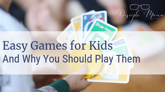 Toddler holding UNO cards with text overlay: Easy Games for Kids and Why You Should Play | Disciple Mama
