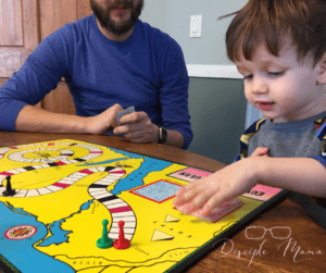 toddler and dad playing a board game | easy games for kids | Disciple Mama