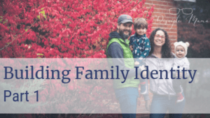 Father, mother, a young boy, and a baby in front of a red bush with text overlay: Building Family Identity, Part 1