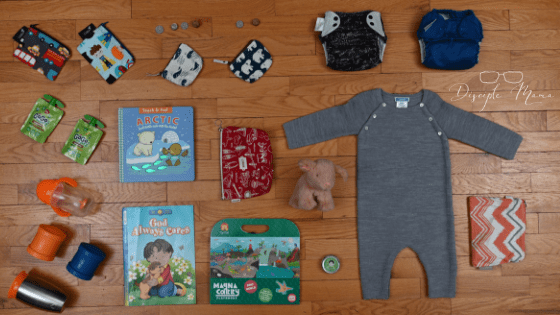 various children's items from church bag on the floor | Disciple Mama