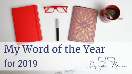 Various items on a white marble background with text overlay: My Word of the Year for 2019 | Disciple Mama