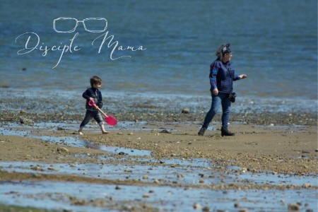 Preschooler running behind a woman on a beach- Benefits of outdoor play for toddlers and preschoolers | Disciple Mama