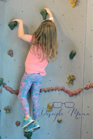 Girl on a climbing wall | Disciple Mama